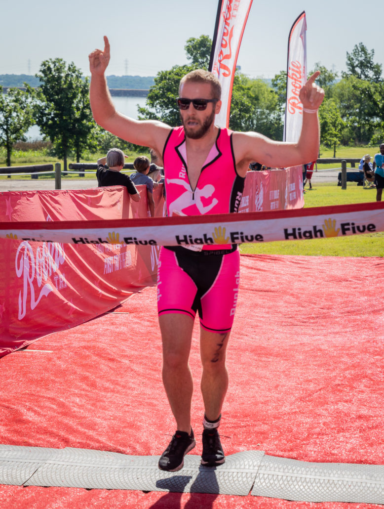 crossing the finish line at my first triathlon